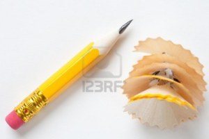 4373672-very-short-yellow-pencil-with-shavings-on-textured-white-paper